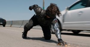Screenshot from Captain America: The Winter Soldier showing the Winter Soldier in action, his arm clearly visible.